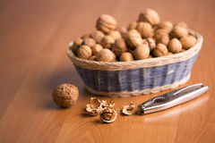 Nuts in a basket with the nutcracker. Stock Images