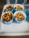Nuts in blue and white tubs stock photos