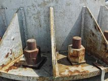 Nuts and bolds on  iron pylon. Nuts and bolds on rusty  iron pylon base royalty free stock photography