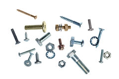 Nuts and bolts. An assortment of nuts and bolts on a white background Stock Photo