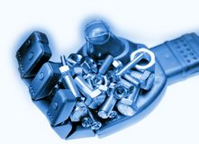 Nuts and bolts. In robot hand Stock Photo