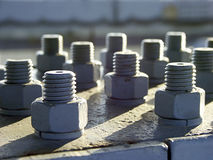 Nuts and bolts. Rows of nuts and bolts Stock Photos