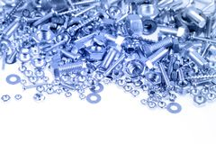 Nuts and bolts. On plain background Royalty Free Stock Photo