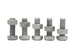Nuts & bolts. Nuts and Bolts on a white background Royalty Free Stock Photo