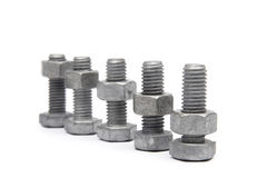 Nuts & bolts. Nuts and Bolts on a white background Royalty Free Stock Image
