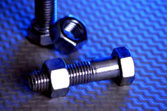 Nuts and Bolts 3. Nuts and Bolts with colorful lighting Royalty Free Stock Image
