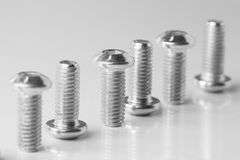 Nuts and Bolts. On white and gray background stock photography