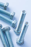 Nuts and Bolts. On bluish background royalty free stock image