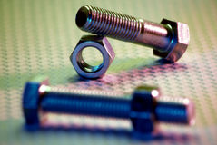 Nuts and Bolts 4. Nuts and Bolts with colorful lighting Royalty Free Stock Photo
