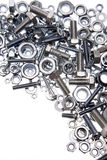 Nuts and bolts. Closeup over white Royalty Free Stock Photography