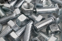 Nuts and Bolts. Carefully arranged to look like a 'random' pile Stock Photos