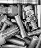 Nuts and bolts. Machine shop box of nuts, bolts and pins of various sizes Royalty Free Stock Photos