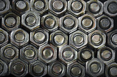 Nuts and Bolts Background. Close up view of nuts and bolts Stock Photos
