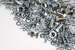 Nuts and bolts. Chrome nuts and bolts closeup Royalty Free Stock Photography
