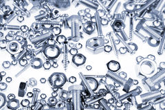 Nuts and bolts. Chrome nuts and bolts closeup Royalty Free Stock Images