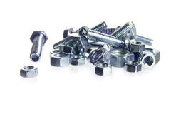 Nuts and bolts on a heap isolated on a white background, concept Stock Photo