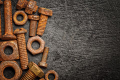Nuts and bolts on a  metallic background Stock Images