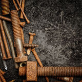 Nuts and bolts on a  metallic background Royalty Free Stock Photos