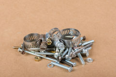 Nuts Bolts Screws & Clamps. Pile of assorted hardware including screws, clamps, washers, nuts Stock Photo