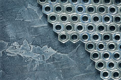 Nuts, bolts, screws on a dark concrete background Stock Image