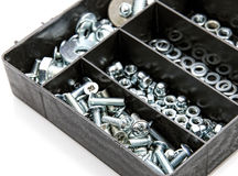Nuts and bolts. Bolts and nuts in a special black box Stock Photos