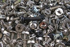 Nuts and bolts. Twist screw background pattern texture. Alloy silver metal screws as wallpaper cover. Photo Royalty Free Stock Image