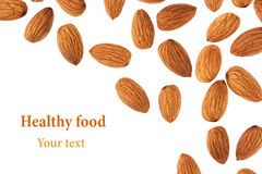 Nuts border of almonds on white background. Pile of selected almond close-up. Isolated. Stock Image