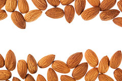 Nuts border of almonds on white background. Pile of selected almond close-up. Royalty Free Stock Photos