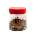 Nuts in the bottle with isolated white background Royalty Free Stock Images