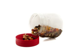 Nuts in the bottle with isolated white background Royalty Free Stock Image