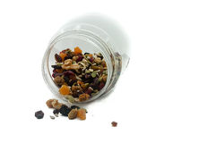 Nuts in the bottle with isolated white background Royalty Free Stock Photos
