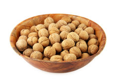 Nuts in a bowl. Bowl filled with nuts isolated on white Stock Photography