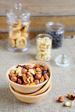 Nuts in a bowl and jars Royalty Free Stock Photography