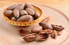 Nuts in bowl Stock Images