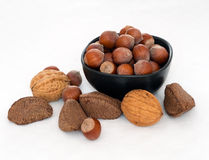 Nuts in bowl on white tablecloth - hazelnuts, brazils, walnuts Stock Photography