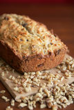 Nuts bread. Warm and fresh nuts bread with nuts on a wood cutting board Stock Photography