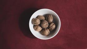 Nuts breakfast Gourmet healthy natural raw wood fruit. Tuts food Gourmet healthy natural raw breakfast wood vegan vegetarian red royalty free stock image