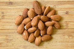 Nuts. Brown nuts  on wooden background Royalty Free Stock Photo