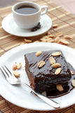 Nuts Brownies & Black Coffee. On a wooden background Royalty Free Stock Photos