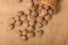Nuts on burlap background Stock Photo