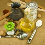 Nuts, butter, salt shaker, coffee beans, a cup Royalty Free Stock Photo