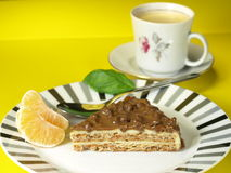 Nuts cake dessert. With coffee and tangerines on yellow background royalty free stock photography