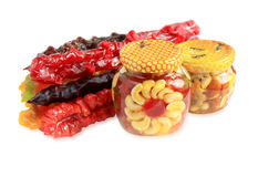 Nuts and candied fruits in honey with churchkhela Royalty Free Stock Photos