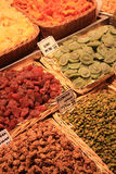 Nuts and candied fruits at the market. Different sorts of nuts and dried fruits at a market in Barcelona Stock Photo