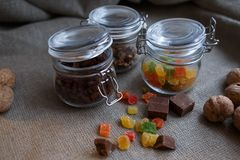 Sweets in glass jars royalty free stock photo