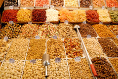 Nuts and candies at market Stock Photography