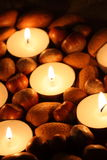 Nuts candles Stock Photos