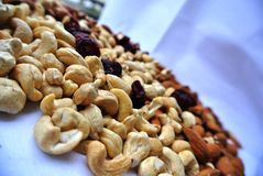 Nuts: cashews, almonds, hazelnuts and dried cranberries Royalty Free Stock Photography