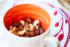 Nuts, cashews, almonds, hazelnuts, peanuts macro. Mixture of nut. S in an orange bowl Stock Photo