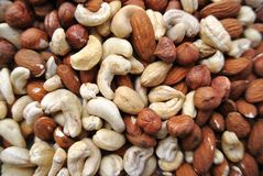 Nuts: cashews, almonds and hazelnuts. A pile of nuts: cashews, almonds and hazelnuts in closeup Stock Photo